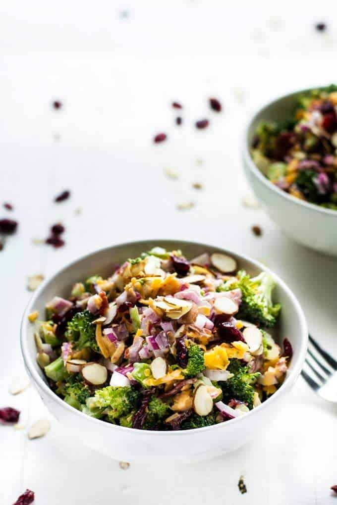 Two bowls of Broccoli Salad with Bacon and Cheddar Cheese - a healthy broccoli salad