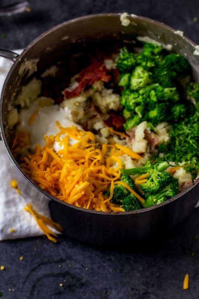Ingredients for Cheesy Mashed Potatoes with Bacon and Broccoli in a saucepan