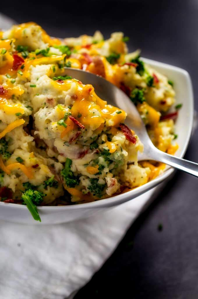 Close up shot of Cheesy Mashed Potatoes with Bacon and Broccoli