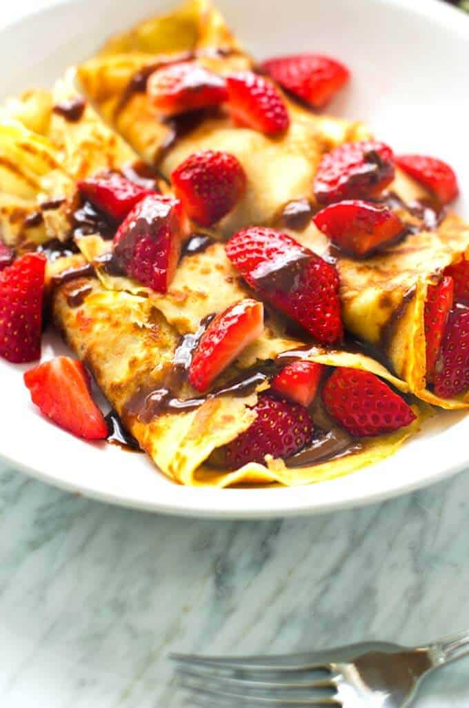 Close up shot of gluten free crepes with chocolate hazelnut sauce