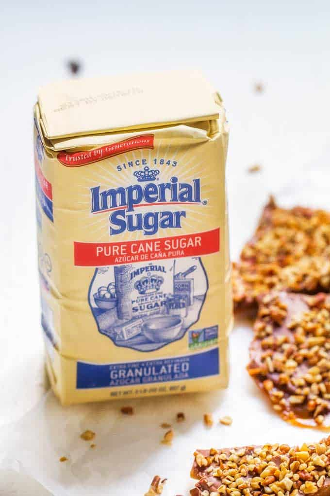 Imperial Sugar with Chocolate Toffee with Pecans in the background