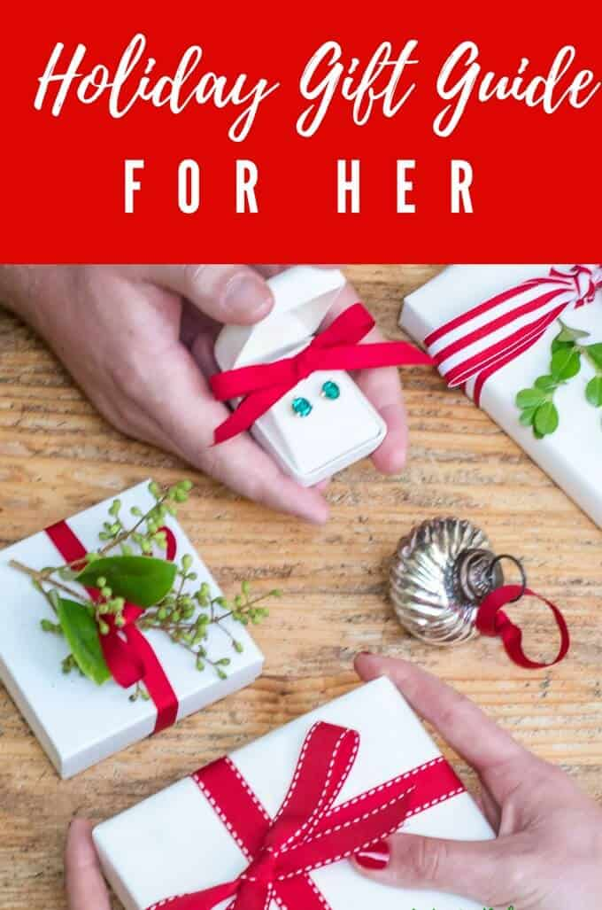 Photo of white presents with red bows on a light background with the text Holiday Gift Guide for Her.