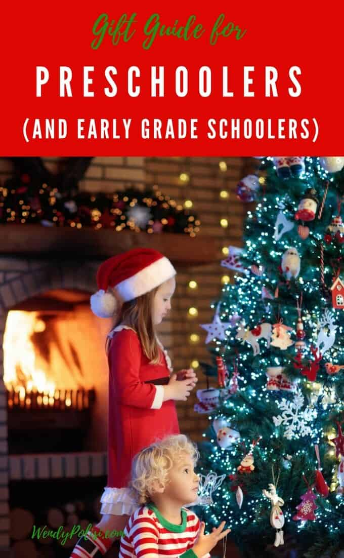 Photo of preschooler looking at a Christmas Tree