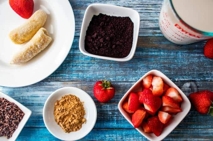 Ingredients for Acai Smoothie in small white dishes.