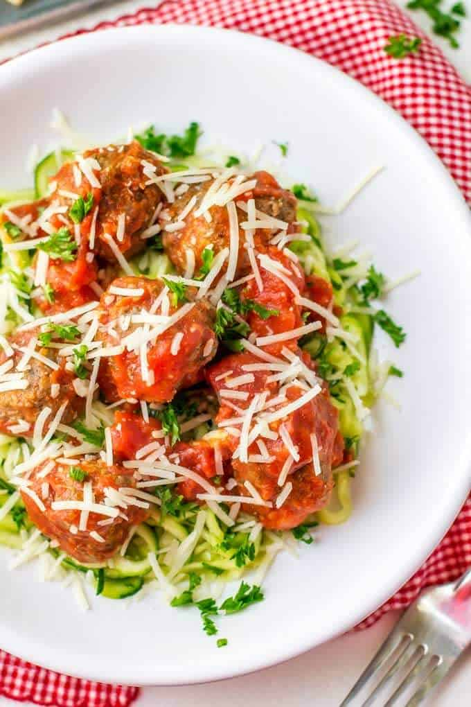 Overhead shot of gluten free meatballs without breadcrumbs served with marinara and zoodles
