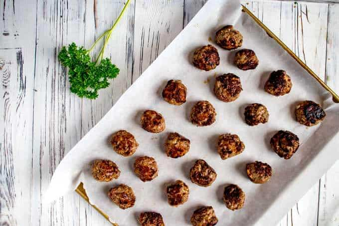 Baking sheet of cooked Gluten Free Meatballs Without Breadcrumbs.