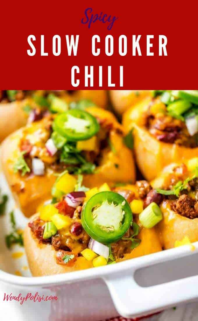 Looking for an easy dinner?  Pull out your crock pot and make this Spicy Slow Cooker Chili Recipe.  It is perfect for game day and the recipe can be doubled for a crowd.