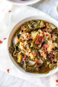Photo of Slow Cooker Collard Greens in a white bowl.