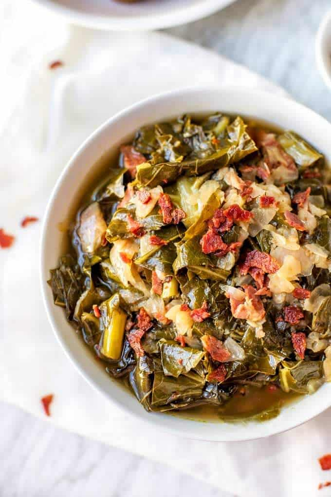 These Southern Style Slow Cooker Collard Greens are the perfect easy recipe for family dinners. Easy to make, this gluten free dish is the perfect comfort food. #slowcookercollardgreens #easyrecipes #collards #SoutherSides