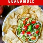 "Photo of Bacon Guacamole in a small dish surrounded by tortilla chips with the text ""Bacon Guacamole"" above it."