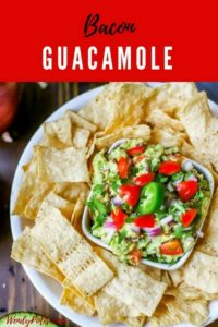 """Photo of Bacon Guacamole in a small dish surrounded by tortilla chips with the text """"Bacon Guacamole"""" above it."""