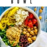 "Photo of a Mediterranean Bowl made in a white bowl sitting on a blue background with the text ""Mediterranean Bowl"" above."