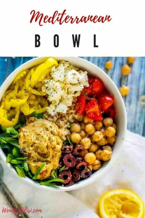 """Photo of a Mediterranean Bowl made in a white bowl sitting on a blue background with the text """"Mediterranean Bowl"""" above."""