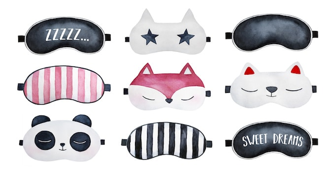Cute photo of 9 different sleep masks against a white background.
