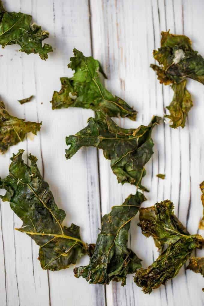 Photo of homemade kale chips on a wooden board