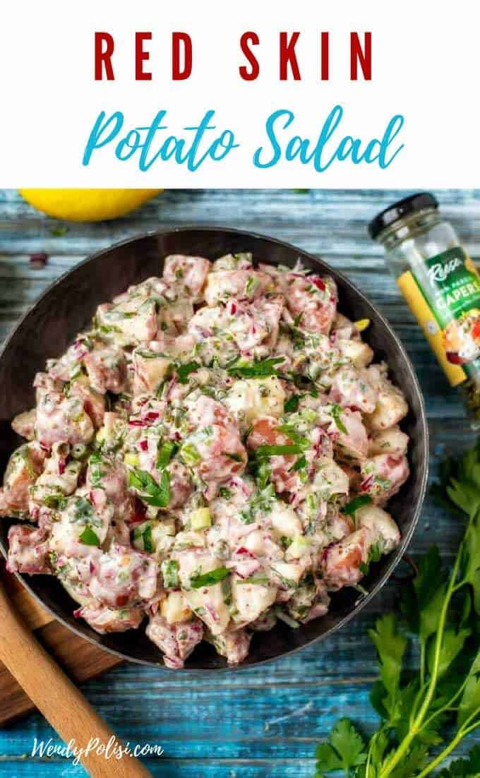This Red Skin Potato Salad is a great way to mix things up. With capers, parsley, and a tangy yogurt-mayo dressing, this Red Skin Potato Salad recipe is anything but traditional. #ad #stepoutofyourcomfortfood @reesespecialtyfoods #potatosalad #sidedish #springfood
