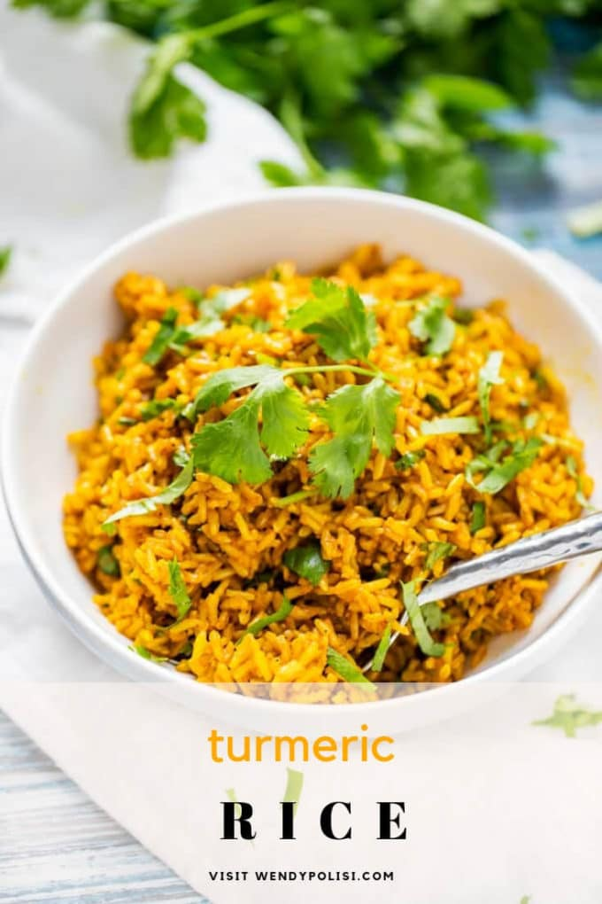 Photo of Turmeric Rice in a white bowl garnished with cilantro with the text Turmeric Rice below.