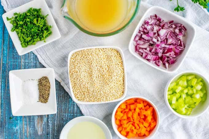 Photo of the ingredients needed to cook quinoa in small white prep bowls.