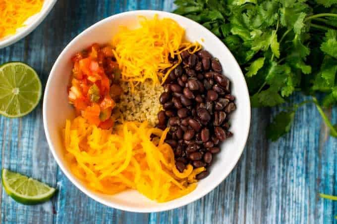 Photo of quinoa breakfast bowl with quinoa, butternut squash, black beans, salsa and cheese
