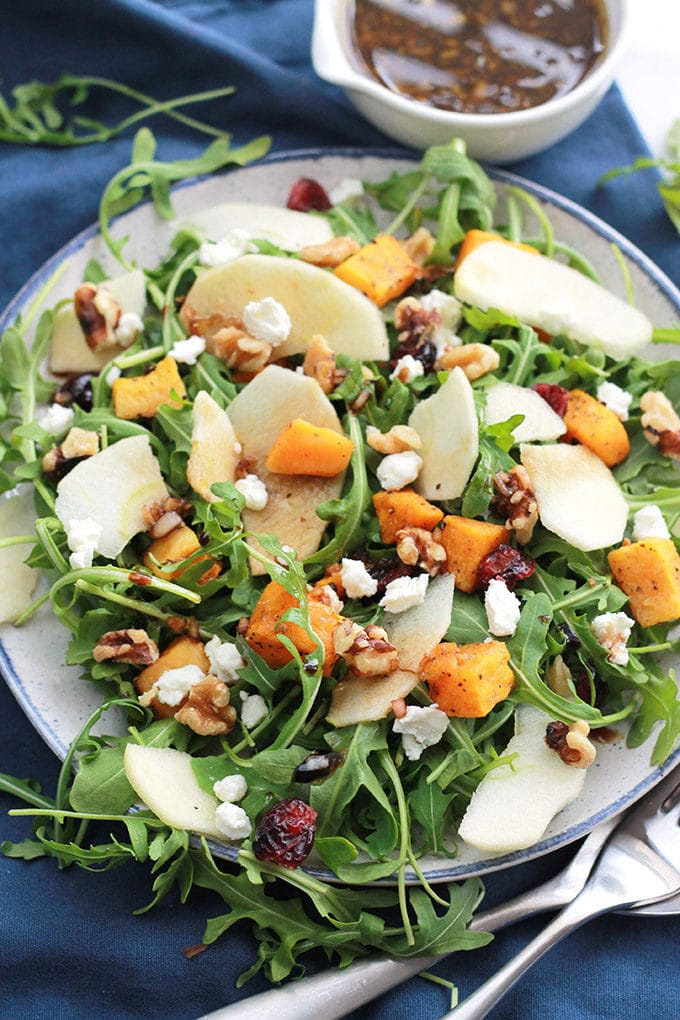 Butternut Apple Arugula Salad with Balsamic Dressing loaded with tender roasted butternut, crisp sliced apple, spicy arugula, sprinkled with dried cranberries, walnuts, and creamy goat cheese.