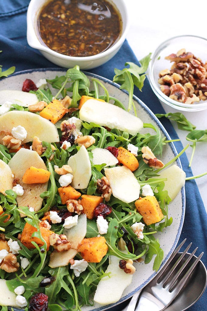 Satisfy your hunger and nourish your body with this delicious Butternut Apple Arugula Salad with Balsamic Dressing, loaded with tender roasted butternut, crisp sliced apple, spicy arugula, sprinkled with dried cranberries, walnuts, and creamy goat cheese.