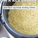 "Photo of quinoa in a rice cooker with the text ""How to Cook Quinoa in a Rice Cooker - Perfect Quinoa Every Time."""