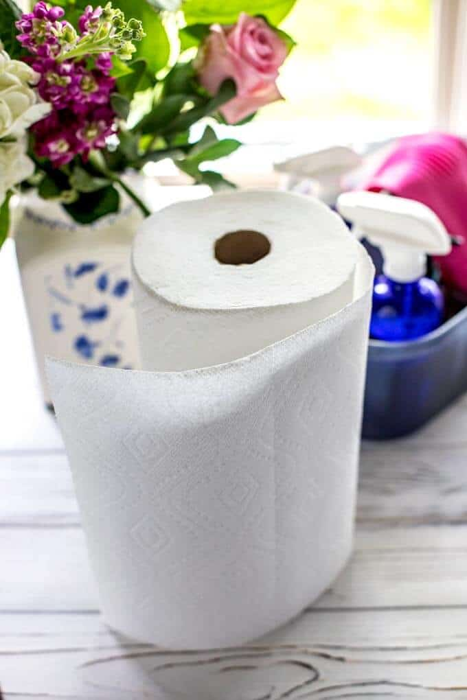 Photo of paper towels and other spring cleaning supplies - Spring Cleaning Tips