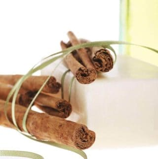 Photo of cinnamon sticks and cinnamon oil.