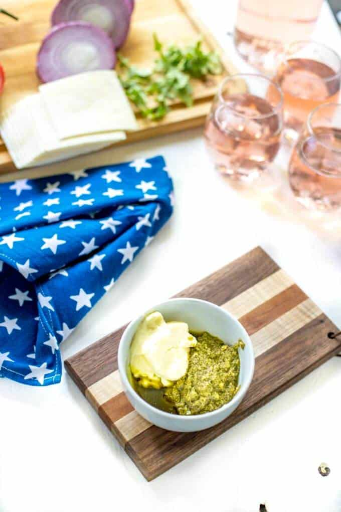 Photo of pesto and mayonnaise in a small white bowl for an Italian Burger Recipe.