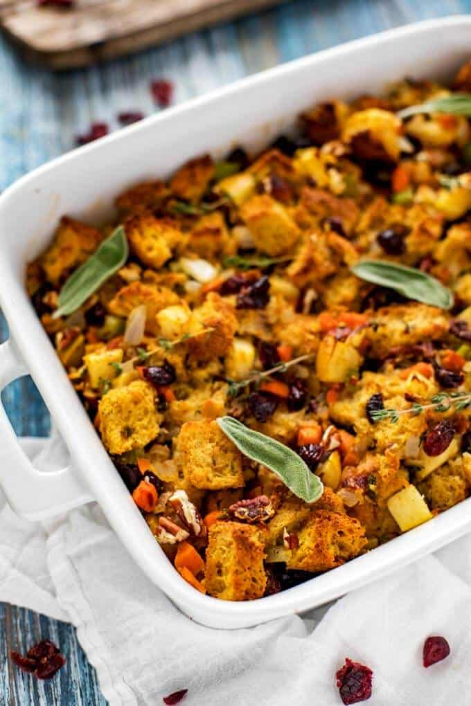 Cooked gluten free stuffing in a white casserole dish.