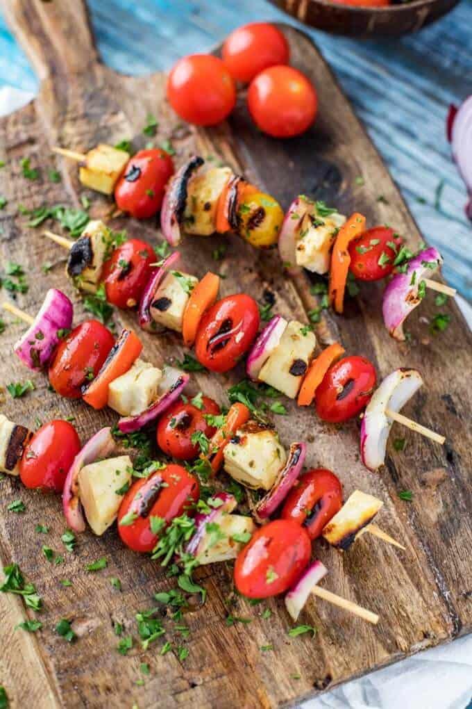 Overhead photo of Halloumi Kebabs on a dark cutting board.
