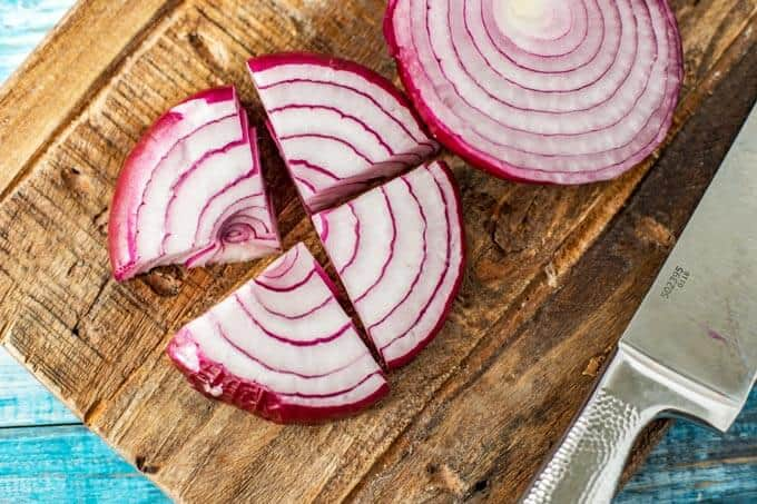 Photo of how to cut an onion for Halloumi Kebabs.
