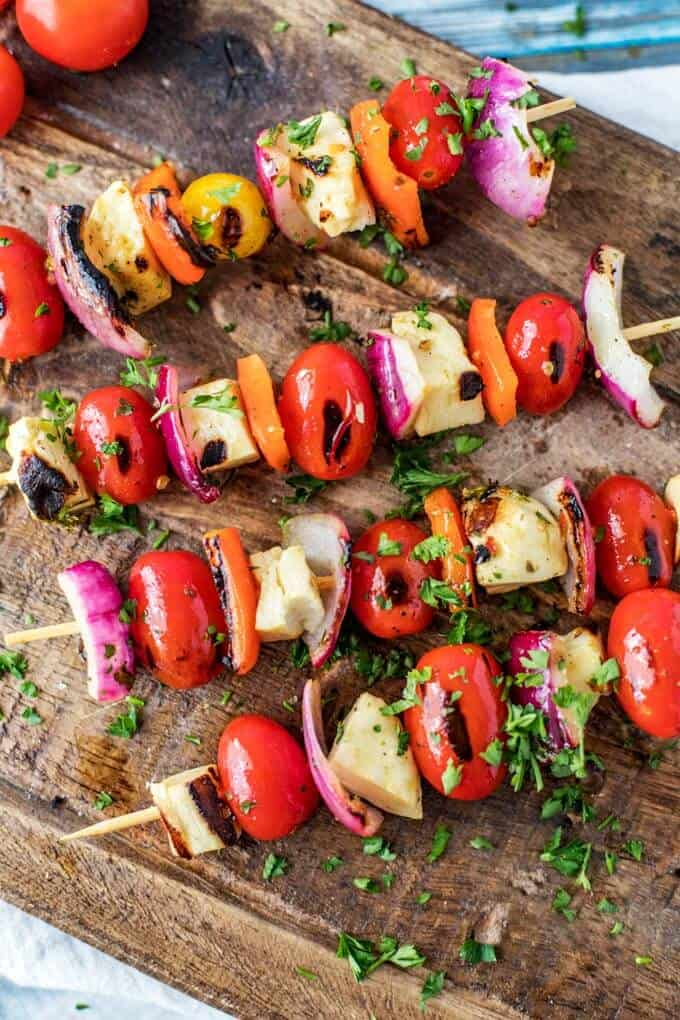 Close up photo of Halloumi Kebabs on a dark cutting board.