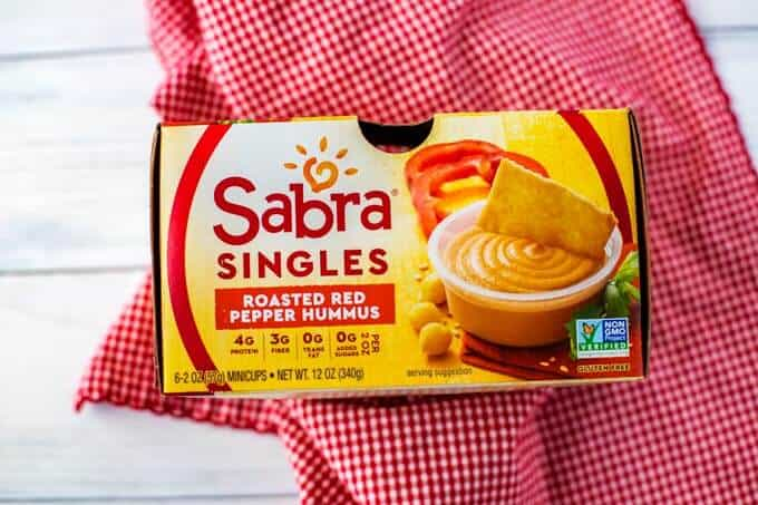 Photo of a 6-pack of Sabra Roasted Red Pepper Hummus Singles.