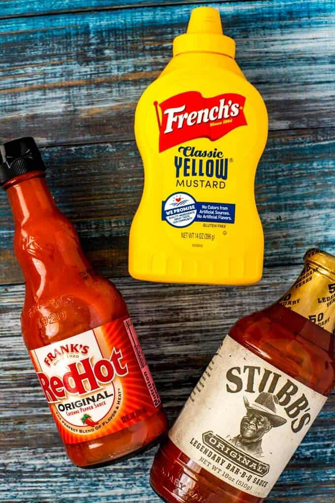 Product shot of Franks Red Hot Sauce, French's Mustard and Stubbs Barbecue Sauce.