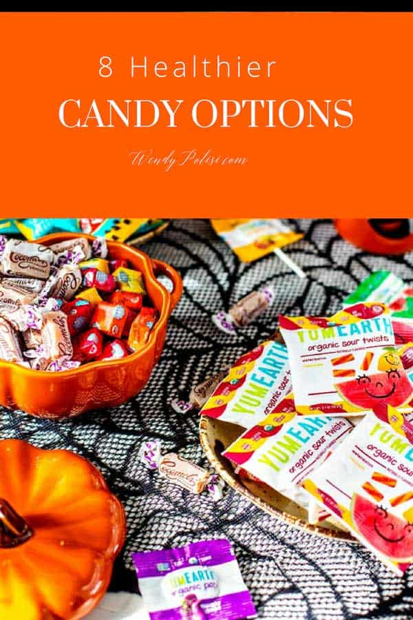 Photo of healthier Halloween candy options on a black and white background with the text 8 Healthier Halloween Candy Options above.
