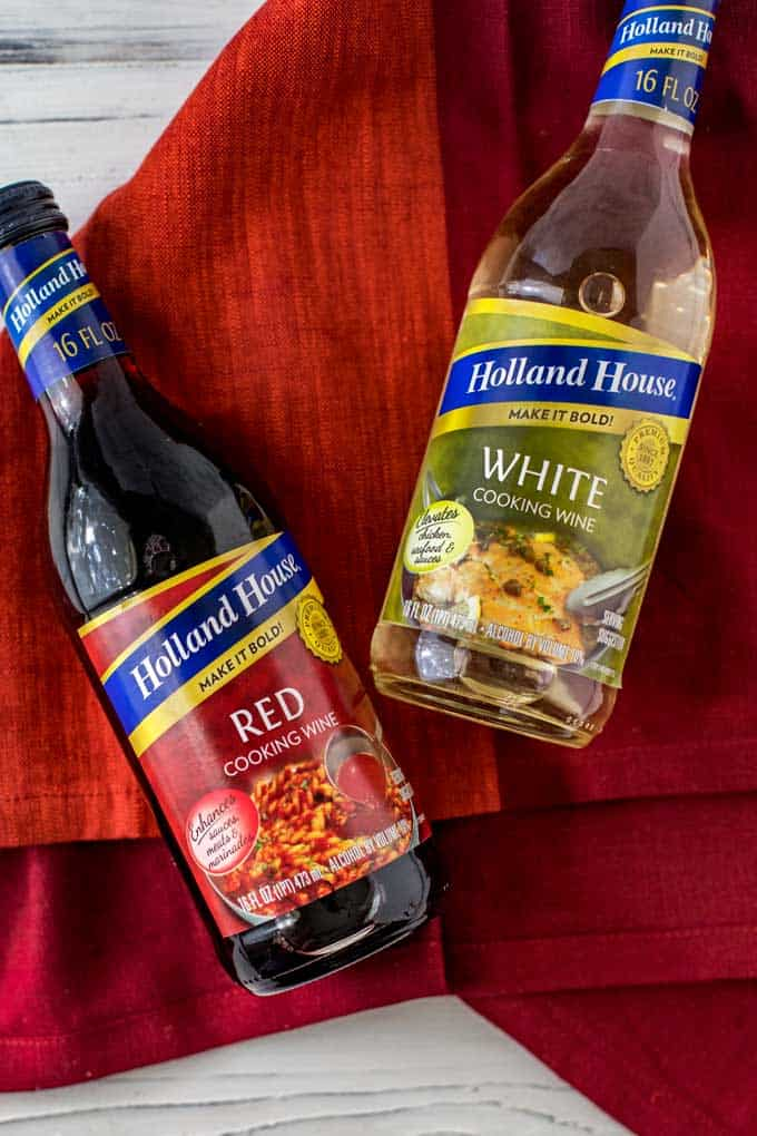 Photo of Holland House Cooking Wines on a dark red napkin against a white background.