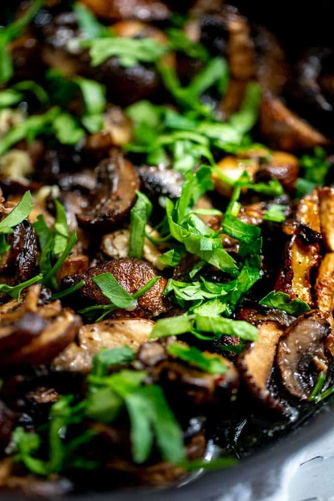 Close up photo of Air Fryer Mushrooms garnished with parsley.