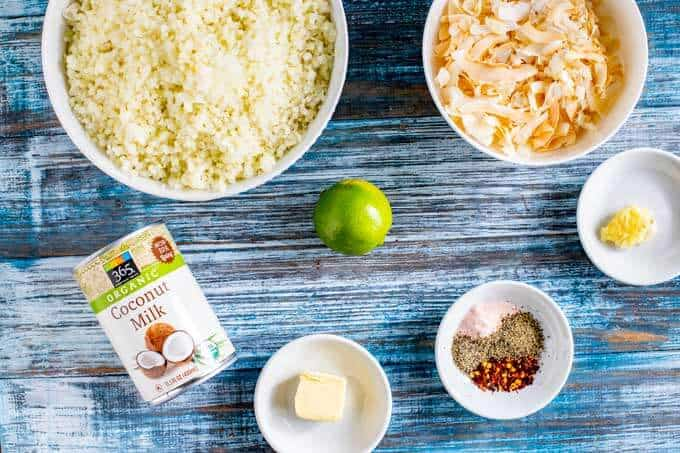 Ingredients for Cauliflower Rice - riced cauliflower, coconut, lime, garlic, seasonings, butter, and coconut milk.