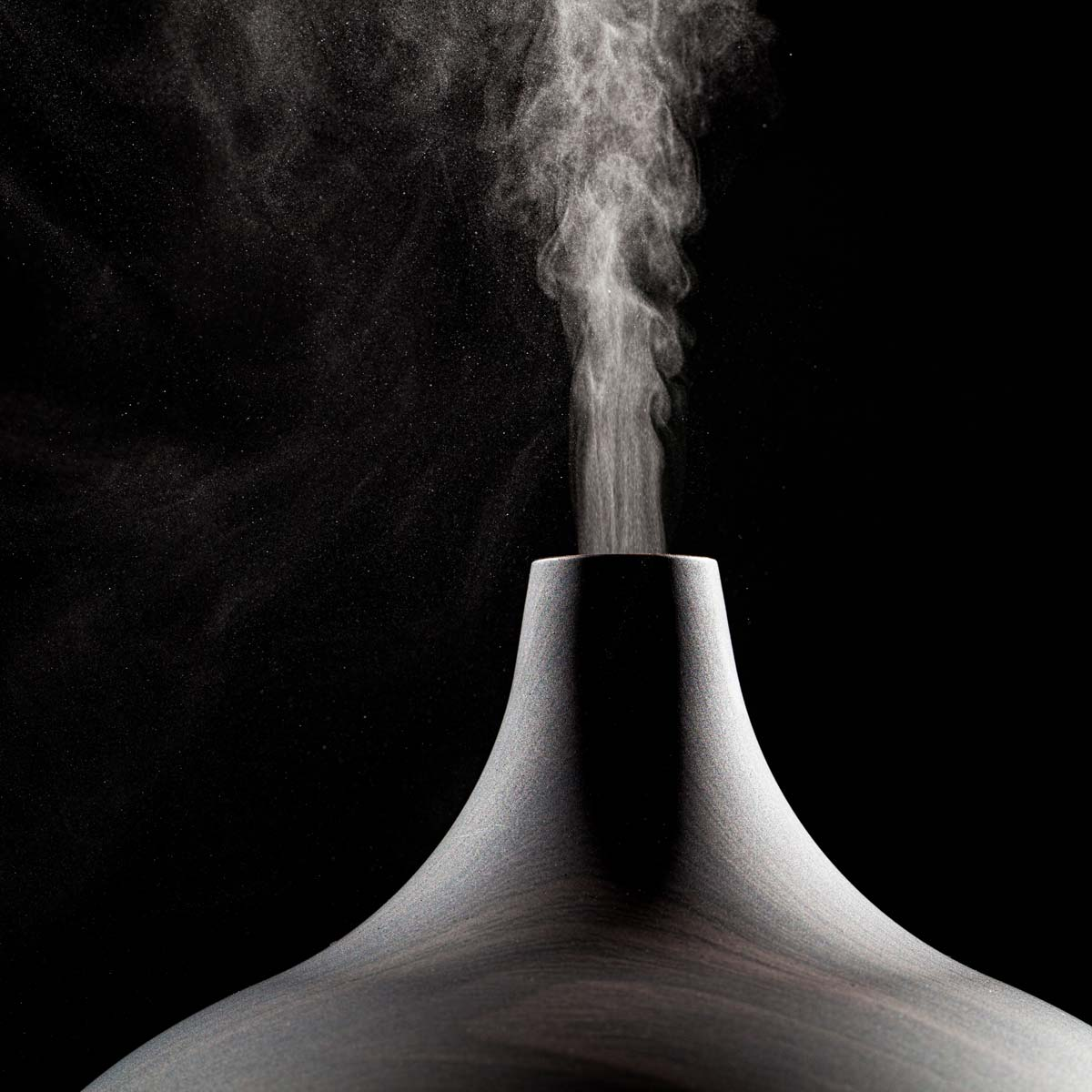 Square close up photo of an essential oil diffuser.