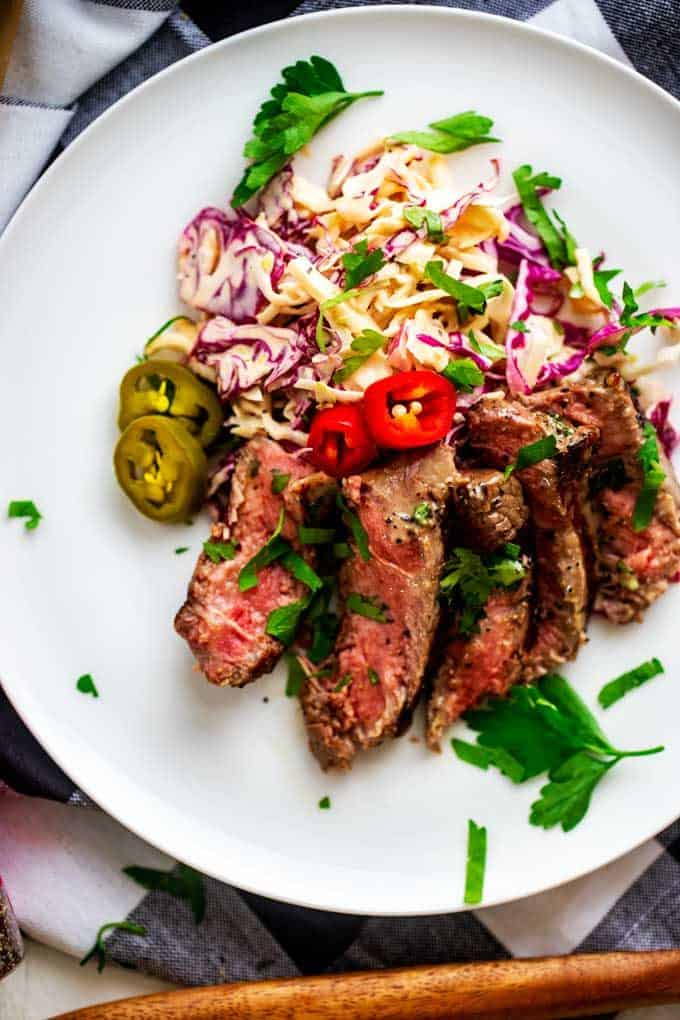 Photo of Grilled Steak with Spicky Slaw on a whtie plate.