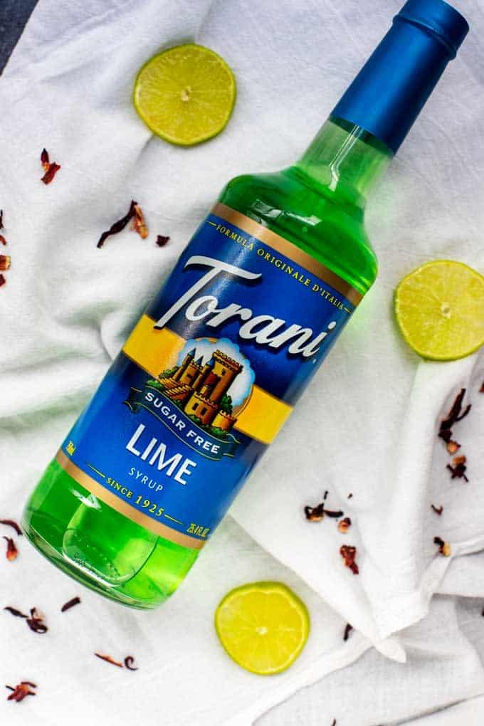 Overhead photo of a bottle of Torani Sugar Free Lime Syrup.
