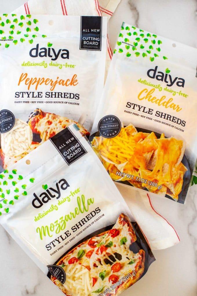 Overhead photo of Daiya pepperjack, Cheddar, and Mozzarella Shreds.