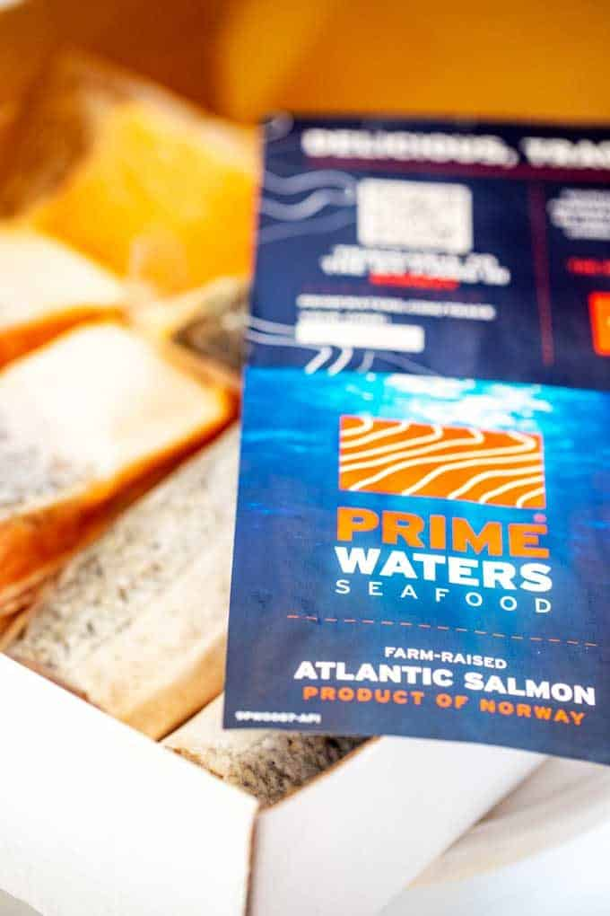 Photo of a box of PrimeWaters Salmon with a company flyer sitting on it.