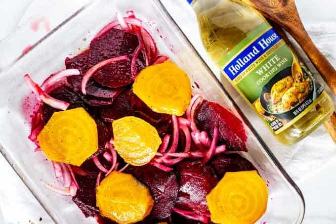 Photo of beets and red onion marinating in a citrus dressing.