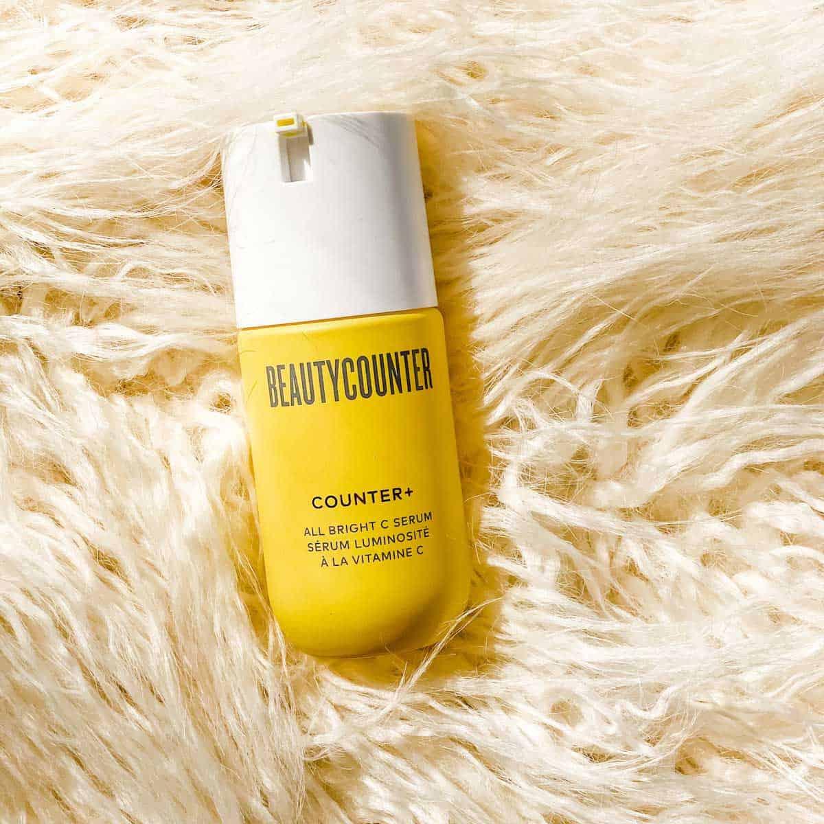 Photo of Beautycounter Counter+ All Bright C Serum on a cream rug.