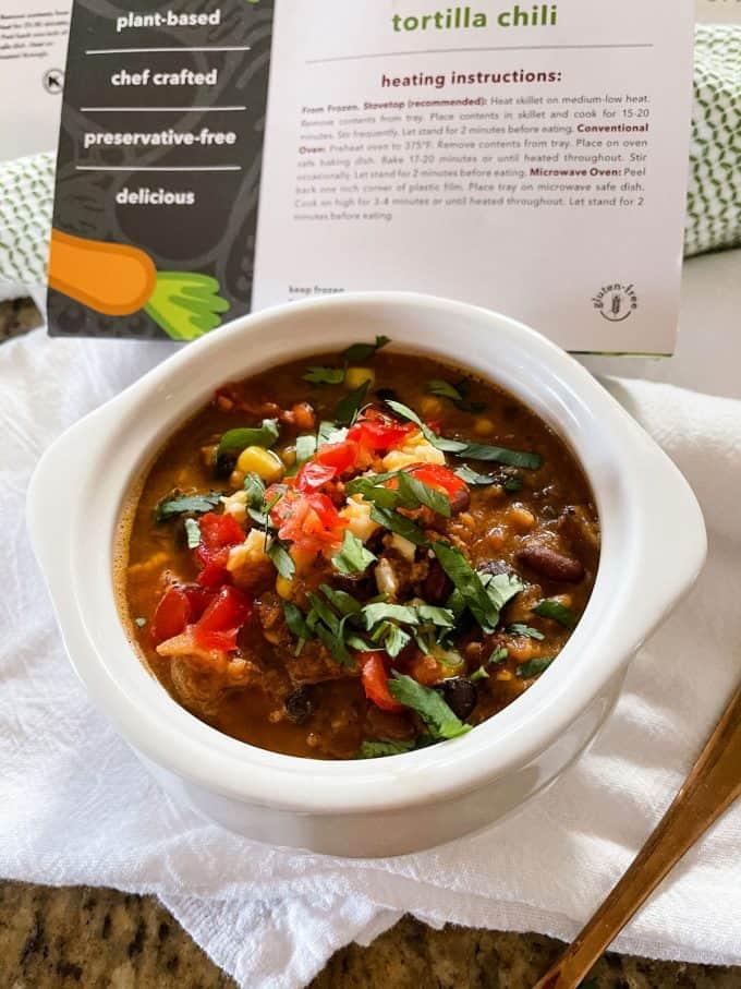 Photo into a white bowl of vegan chili.