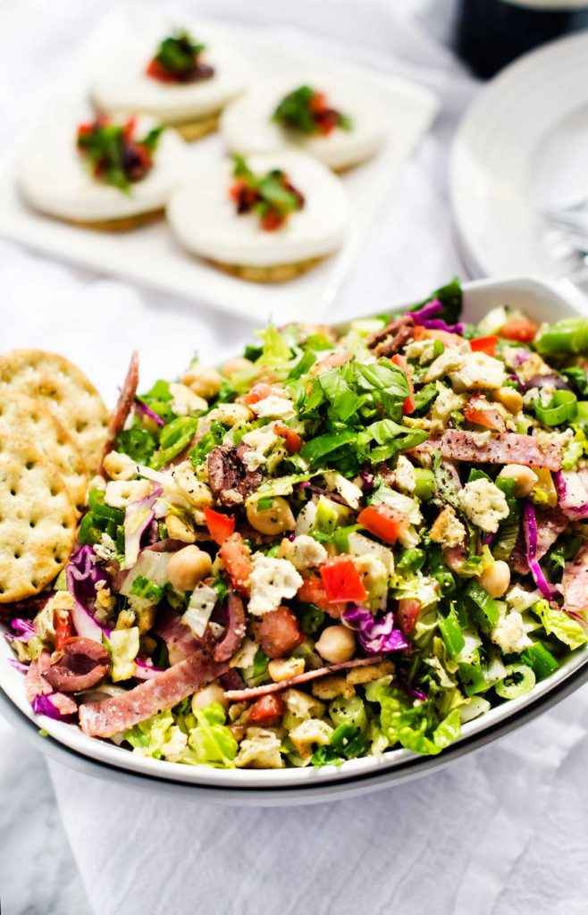 Photo of a large white bowl with an Italian Chopped Salad in it.