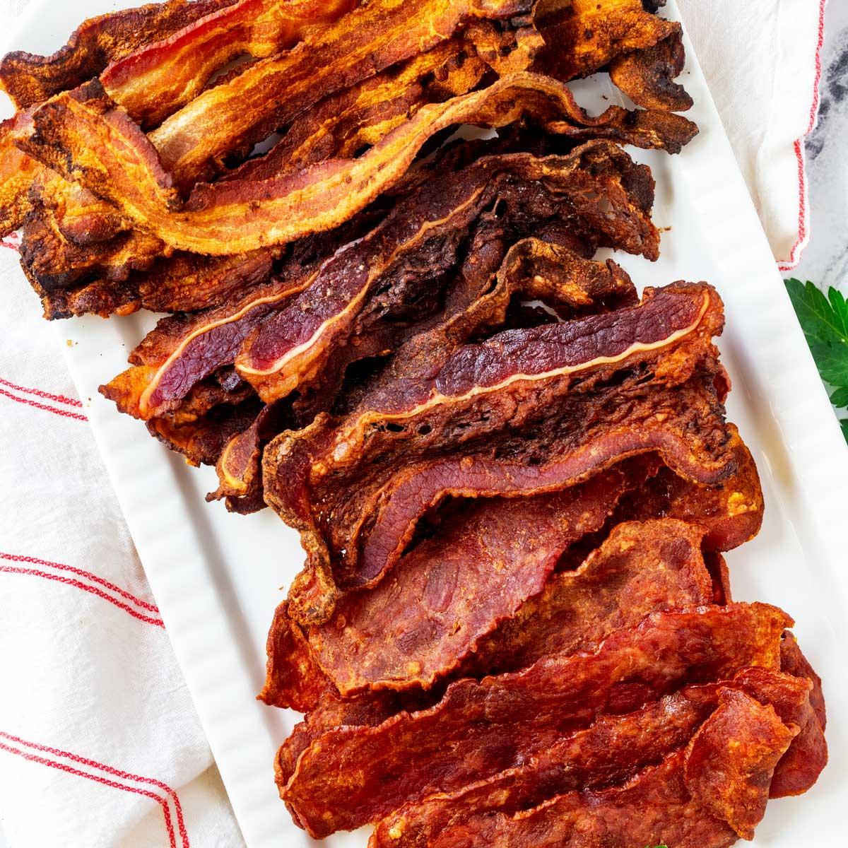 Square photo of ninja foodi grill bacon - turkey bacon, beef bacon and pork bacon.