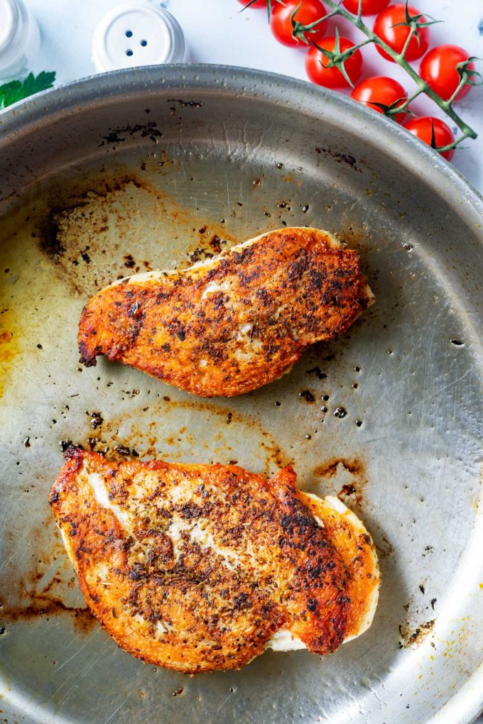 Photos of chicken being browned in a skillet.